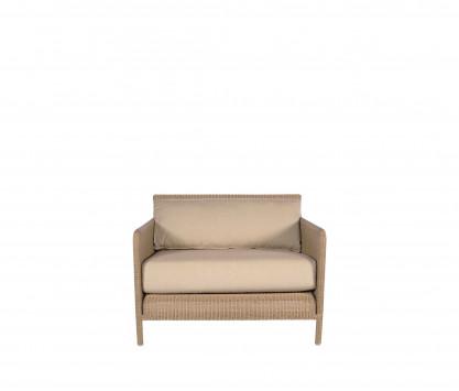 Fireside chair in woven resin